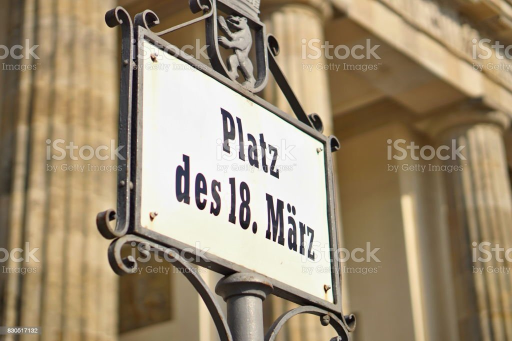 Old signboard with caption Platz Des 18. Marz written in old German font as a symbol of central Berlin stock photo