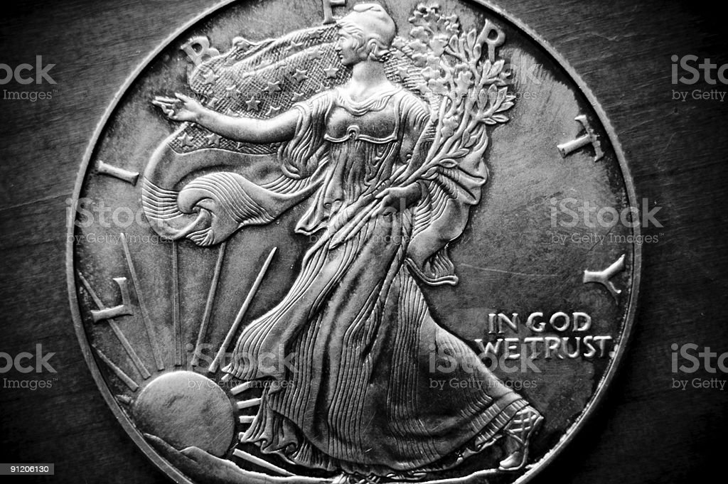 Old silver coin with Lady Liberty stock photo