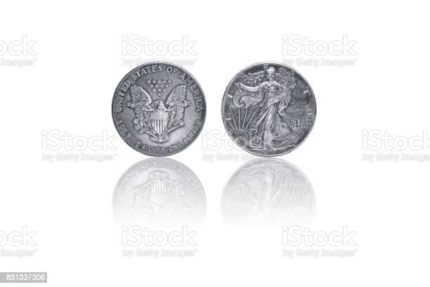 1987 old silver dollar united state of america coin on isolated white background