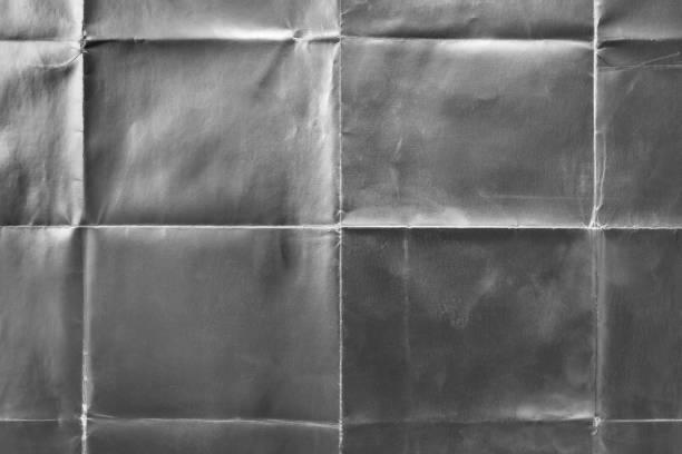gamla silver presentpapper med veck - ihopvikt bildbanksfoton och bilder