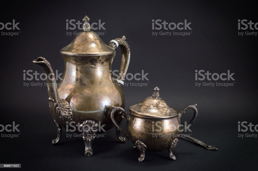 Old silver kitchen utensils on black stock photo