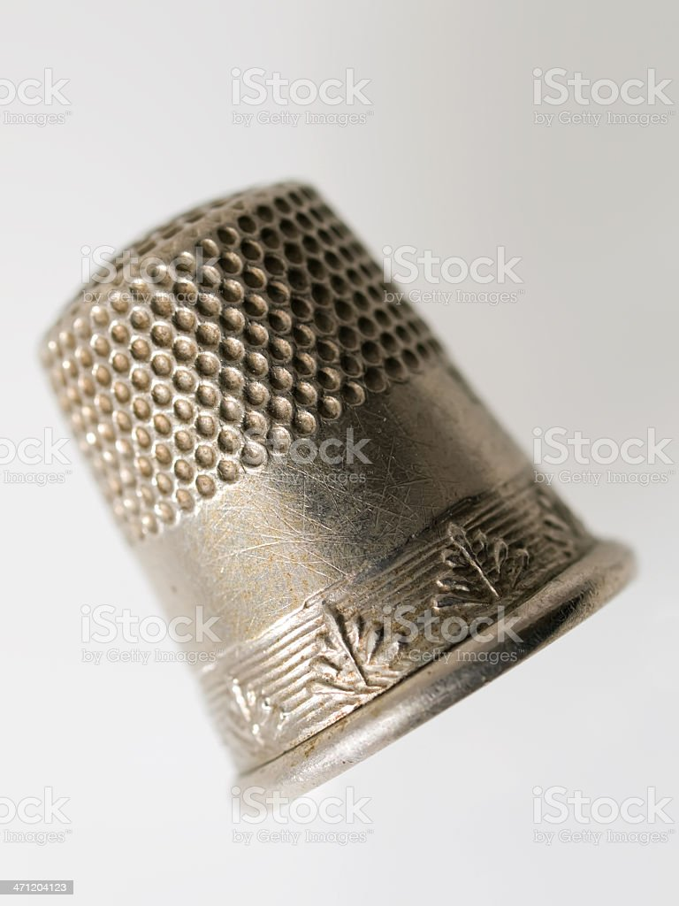 Old Silver Sewing Thimble Close-up View White Background stock photo