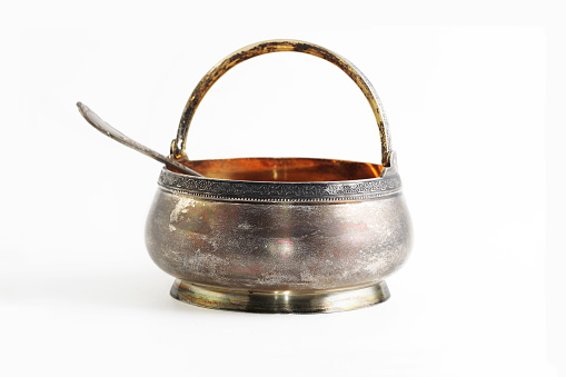 Old silver sugar-bowl and spoon