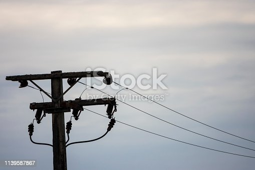 Old simple rural wood electrical pole