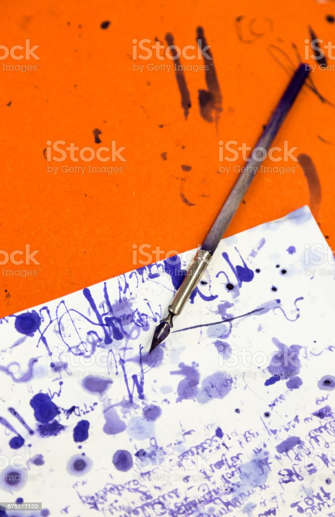 Old simple vintage wooden fountain pen on wooden table in class room stock photo