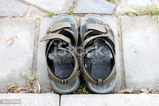 istock Old slippers black sandal on the ground floor 840790408