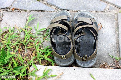 istock Old slippers black sandal on the ground floor 840790468
