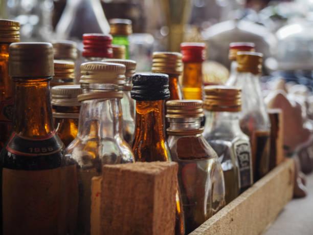 Old small glass drink bottles sold in antique market. Ankara - Turkey stock photo