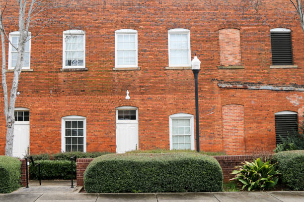 old small town city 2 story brick office building or private residential stock photo
