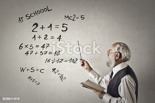 istock Old smart math professor 626641918