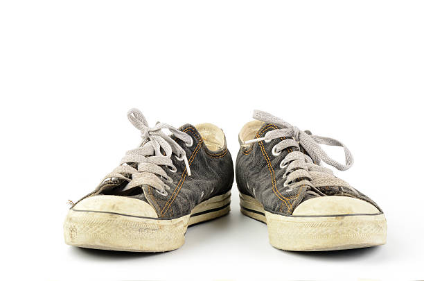 old sneaker - dirty shoes stock photos and pictures