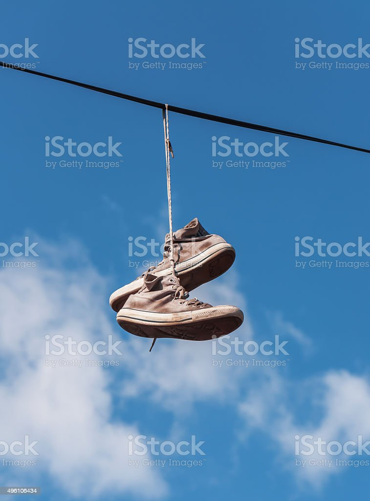 old sneakers on a wire stock photo