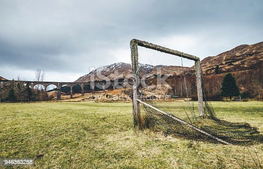 Old soccer gate on the green grass playground near the famous Glenfinnan viaduct in Scotland, United Kingdom.