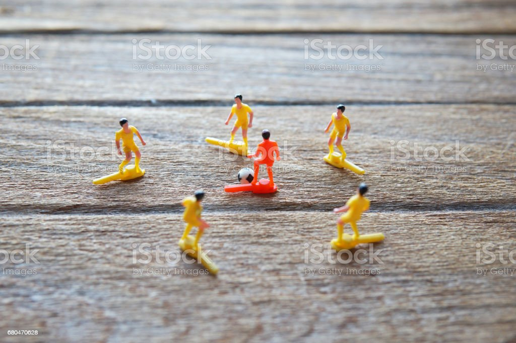 old soccer players toys on wood table. stock photo