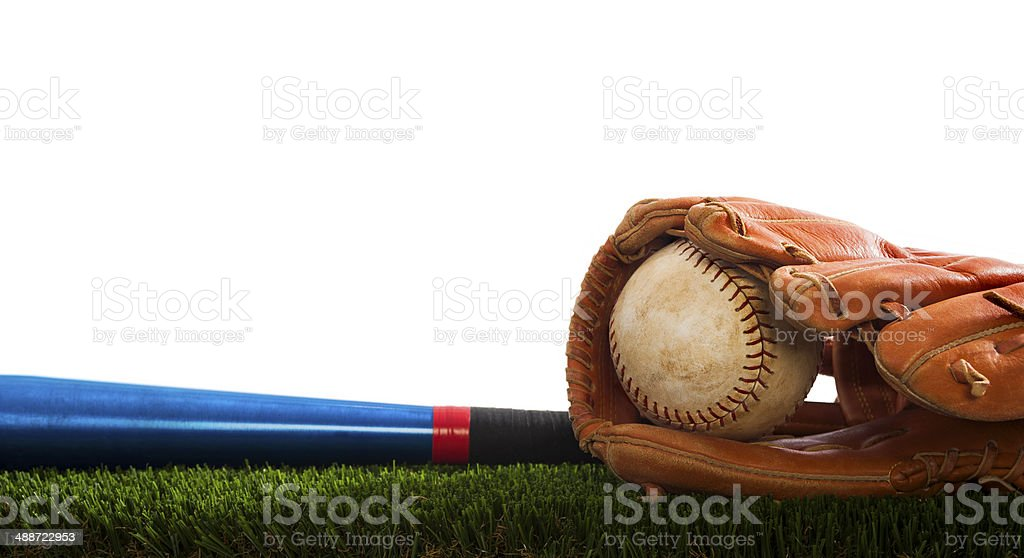 Old Softball in a glove and bat stock photo