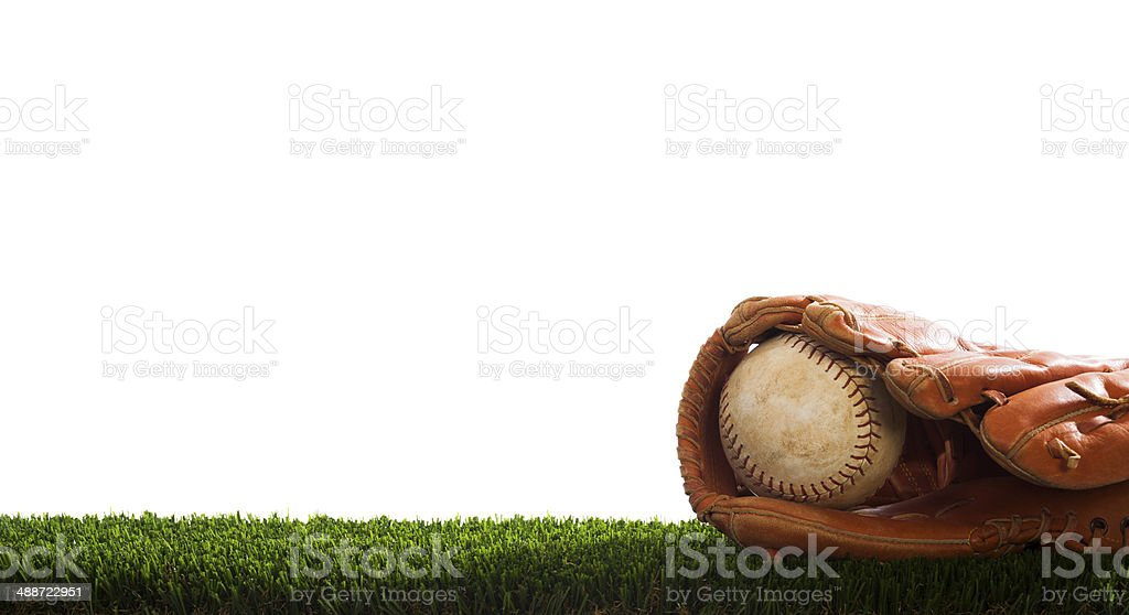 Old Softball in a glove stock photo