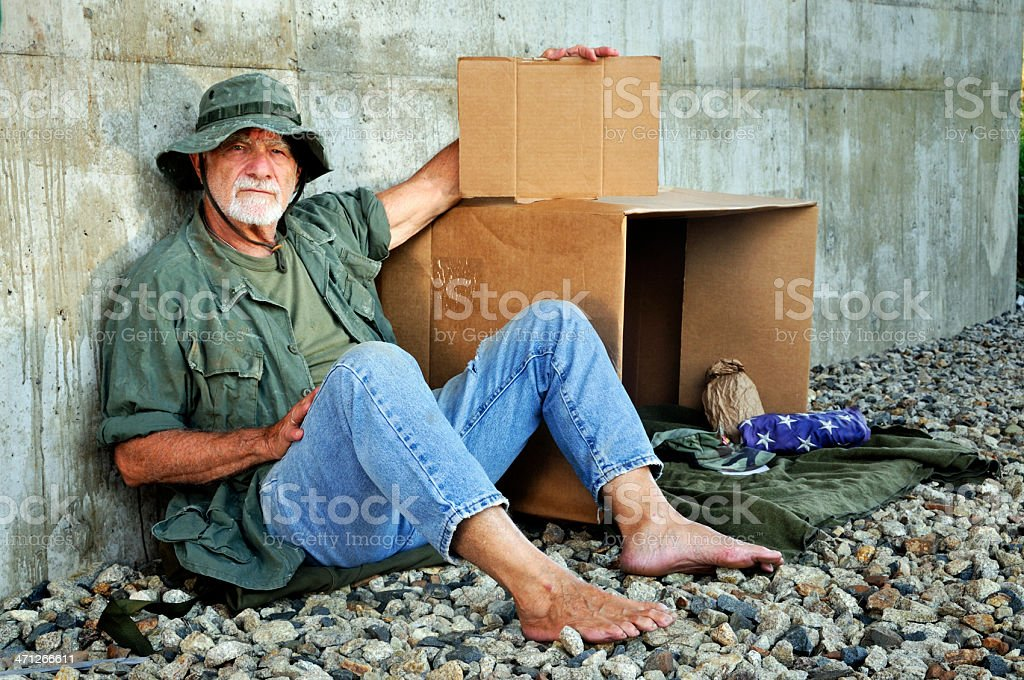 Old Soldier Looks at Camera Holding Blank Sign stock photo