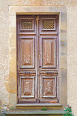 Old solid wood door of a house of Cordes sur Ciel, old medieval village elected favorite village of french, in the Tarn department in the Occitan region.