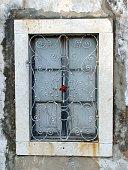 old solid wood window of a Dubrovnik house - Croatia