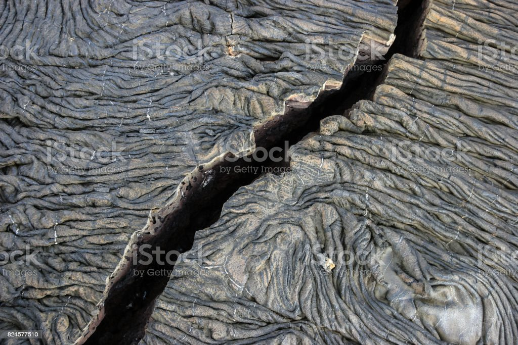 Old solidified lava covers every inch of this volcanic island stock photo
