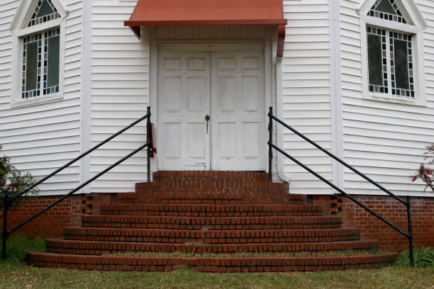 old southern church doors brick steps stock photo