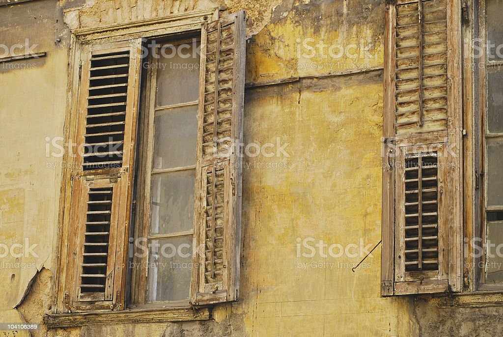 Old Southern Europe house with heavy shutters for sun protection royalty-free stock photo