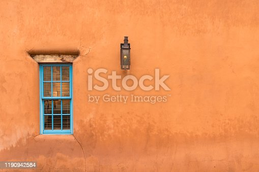 Old Southwestern Brown Adobe Wall with Window and Lantern