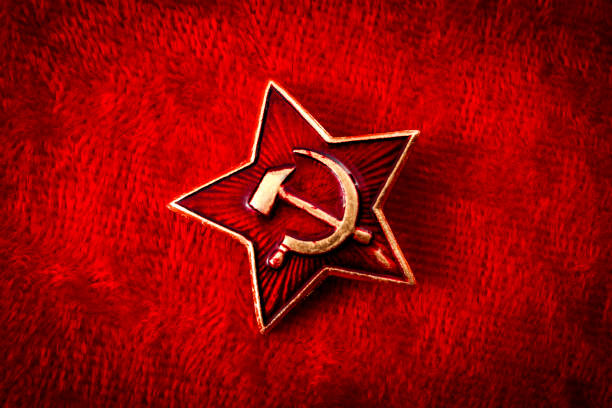 Old Soviet badge with the red star, sickle and hammer stock photo