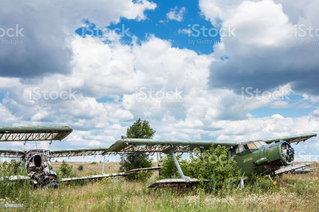 Old soviet biplane Antonov An-2 (Colt) aircrafts on an abandoned airfield in Ukraine stock photo