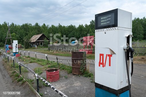 Kamchatka Peninsula, Russian Far East - 30 July, 2018: Old Soviet fuel dispenser with electronic scoreboard for diesel fuel at provincial gas station in Kozyrevsk Village (Ust-Kamchatsky District).