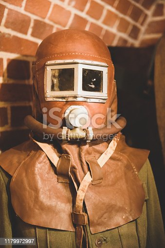 Old Soviet gas mask made of brown leather.