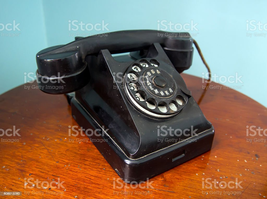 Old Soviet phone 'Bagta-50' stands on a wooden table stock photo