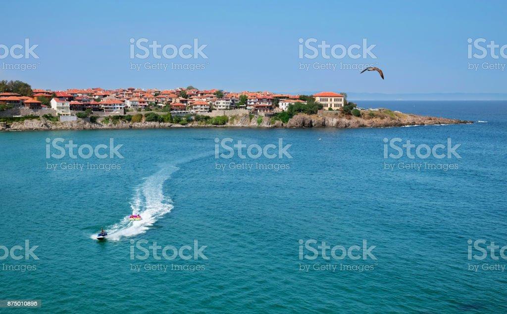 Old Sozopol town and a jet ski. stock photo