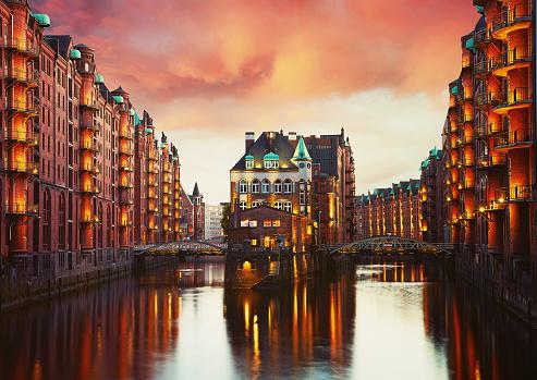 Old Speicherstadt in Hamburg illuminated at night.