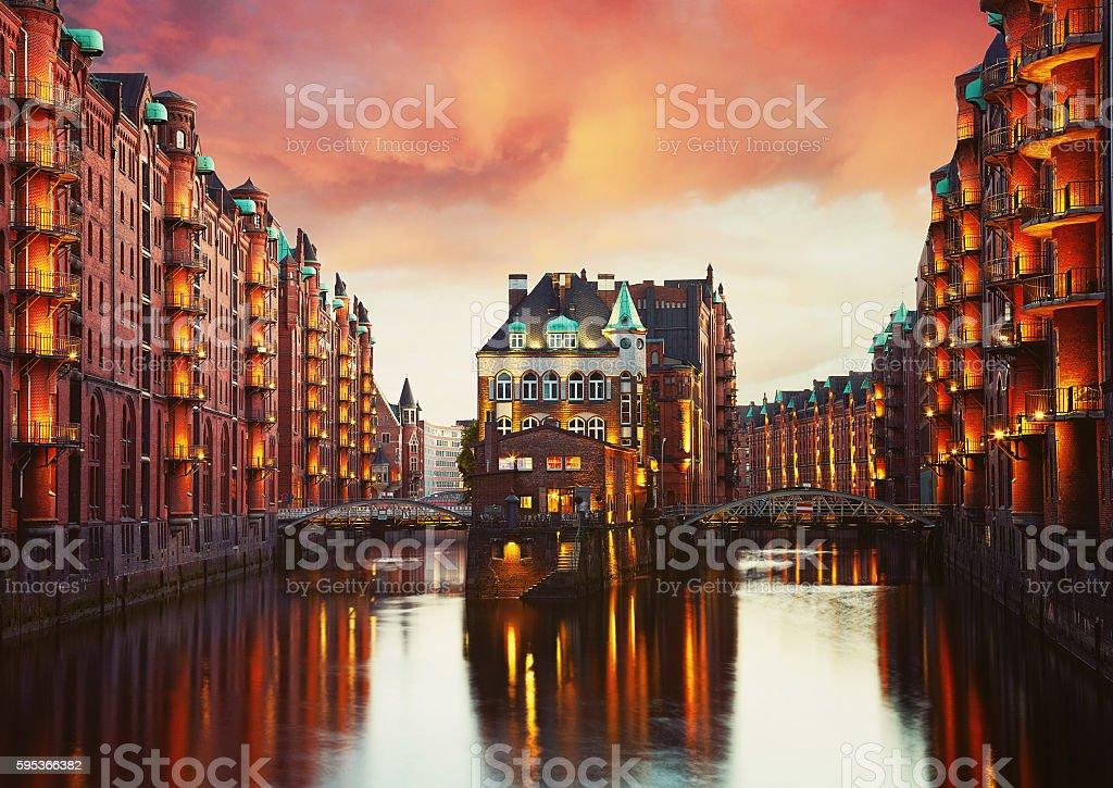 Old Speicherstadt in Hamburg illuminated at night. stock photo