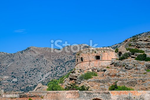 Ruins of main tower of medieval fortress Spinalonga on island Kalydon, Greece.
