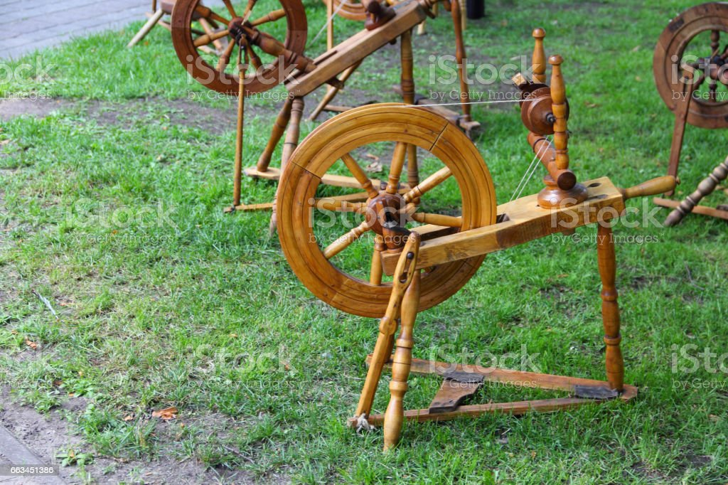 Old spinning wheel stock photo