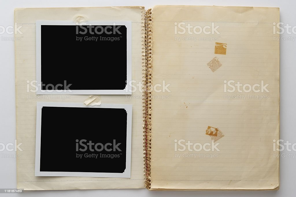Old spiral notebook with two blank polaroid on white background royalty-free stock photo