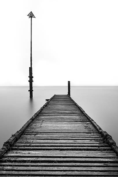 old spooky jetty pier at llandudno, wales, uk. - desolated stock pictures, royalty-free photos & images