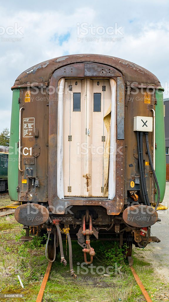 Old spooky train, left at abandoned workshop. stock photo