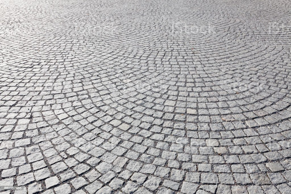 Old square cobble stone paving perspective background