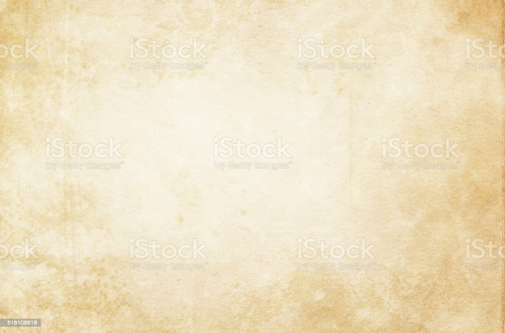Old stained paper texture. Aged spotted paper background for the design. Aging Process Stock Photo