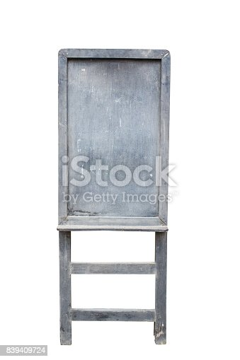 istock Old standing black chalk board isolated on white background. 839409724