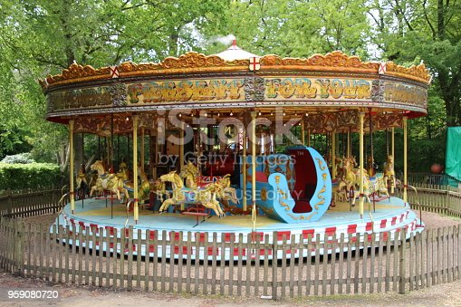 Liphook, UK - 13 May, 2018: Old steam driven fairground attraction at the Hollycombe Steam Fair. One of several restored rides which were commonplace in the early 20th century.