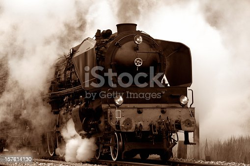 close up shot of old Steam Locomotive in smoke.