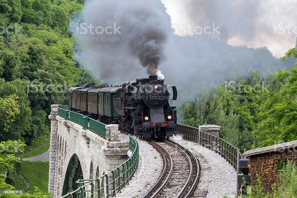 Old steam train crossing the Solkan bridge stock photo