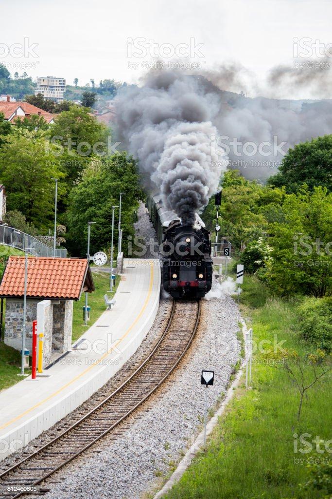 Old steam train leaving the railway station of Solkan-Nova Gorica, Slovenia stock photo