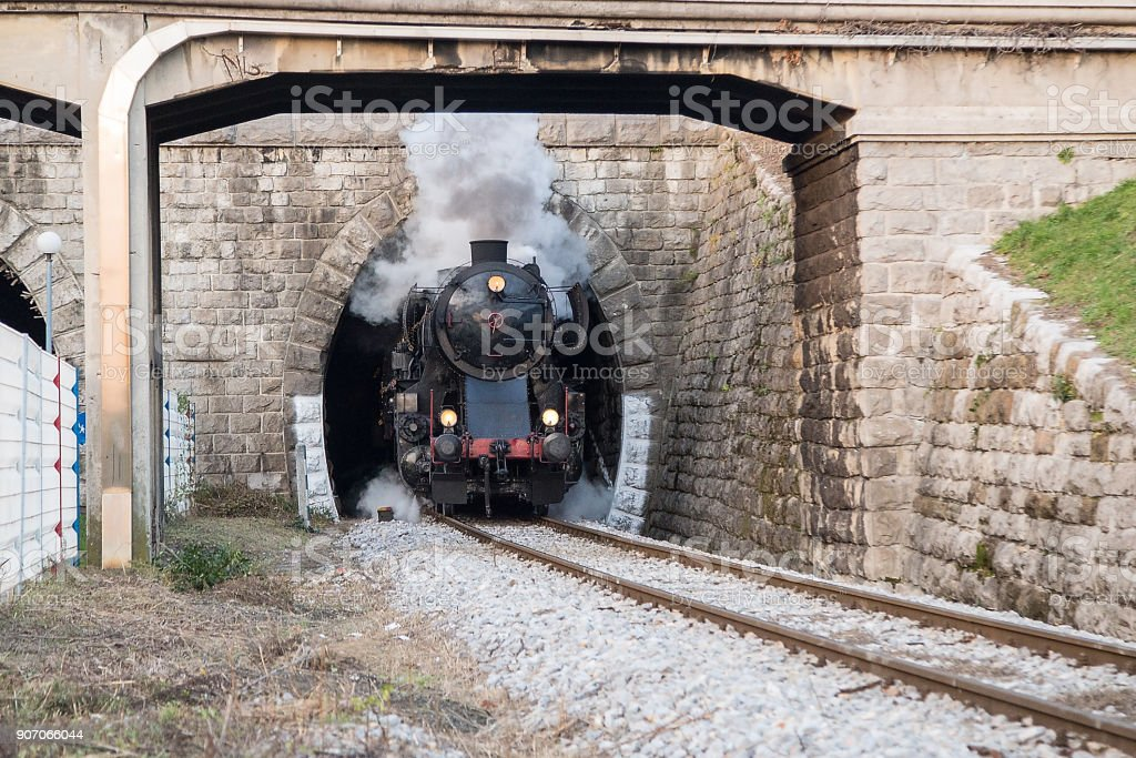 Old Steam train - locomotive in the tunel of Railway Station at Nova Gorica, Slovenia stock photo