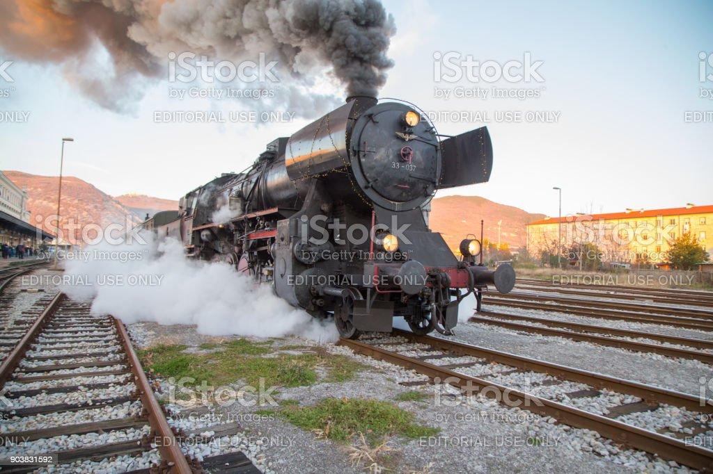 Old Steam train - locomotive is leaving the Railway Station at Nova Gorica, Slovenia stock photo