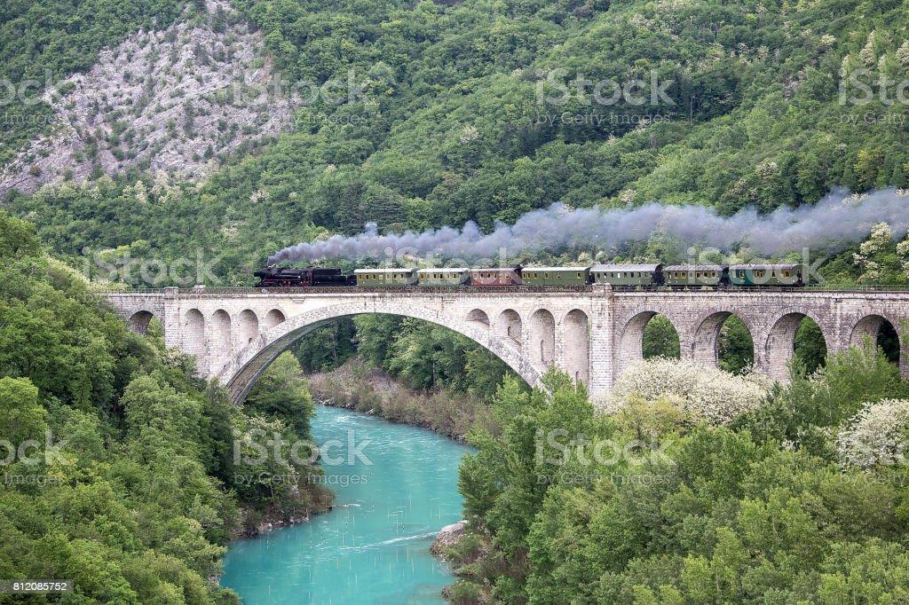 Old steam train on the Solkan bridge stock photo